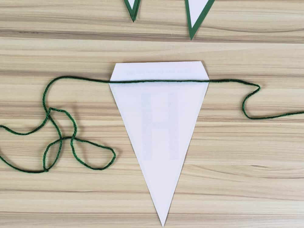 Place the string along the flag's fold