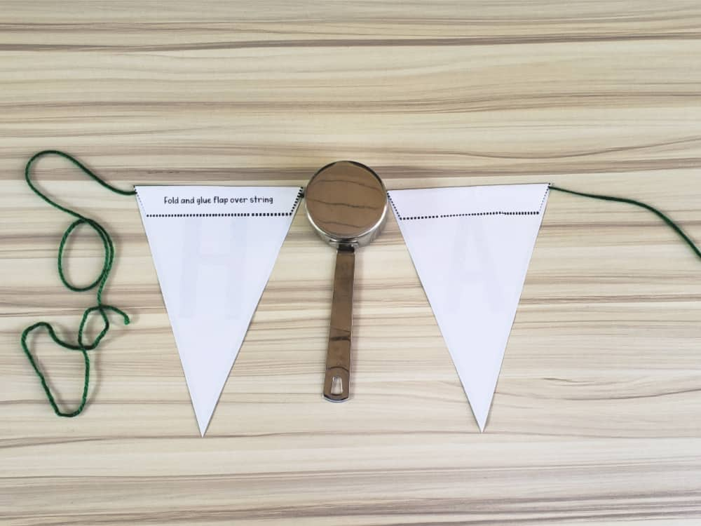 Measure equal spaces between the bunting flags