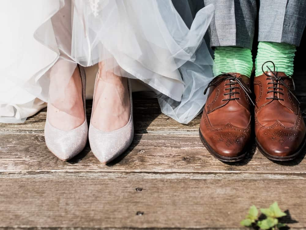Man and woman's feet at wedding